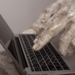 ancient fingers pressing keyboard